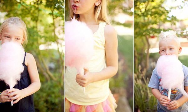 children holding cotton candy